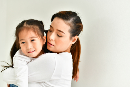 Mom is comforting her baby in the house. Stock Photo