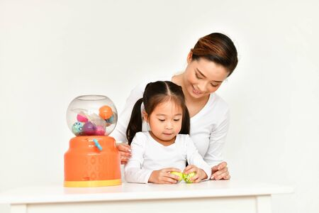 Little girl playing toys with fun at home. 免版税图像