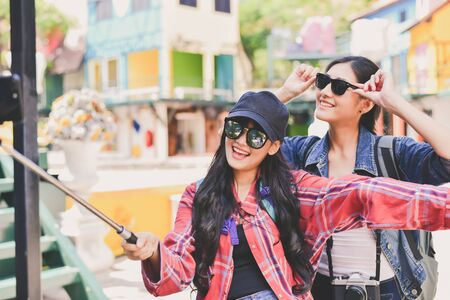 Tourists are taking a selfie in the city.