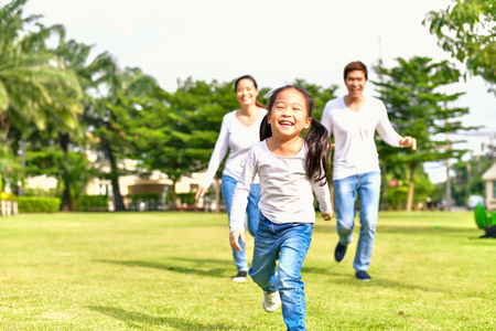 Parents and daughters go for a walk in the park.