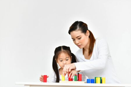 Parents are teaching children to do homework. 스톡 콘텐츠