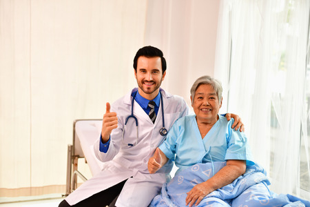 Concept of healing care, The doctor is healing  old woman. 스톡 콘텐츠