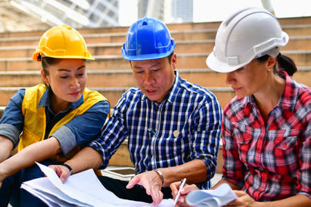 Business Concepts Engineering, Professional engineers, Young Business people are planning construction. Stock Photo