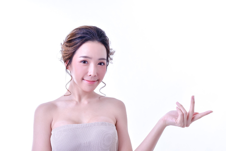 The concept of healthy beautiful woman. Beautiful women keep healthy. Beautiful women are present. Beautiful woman pointing fingers on white background.
