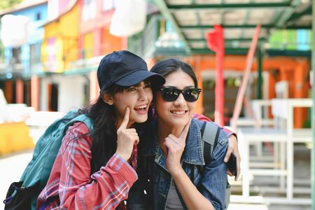 Travel and relaxing Concepts, Tourists are taking photos in the city. Asian girls are happily traveling. Beautiful girl is relaxing Travel Stock Photo