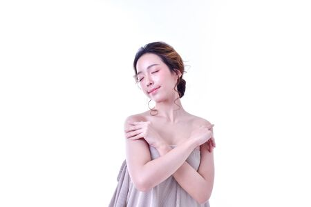 The concept of healthy beautiful woman. Beautiful women keep healthy. Beautiful women take care of skin health. Beautiful girl on white background 스톡 콘텐츠