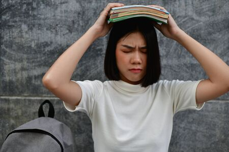 Education Concepts. Beautiful Asian girls are clear in their studies. The study of Asian women looks serious. Asian women Headache because of serious study. education of Asian women