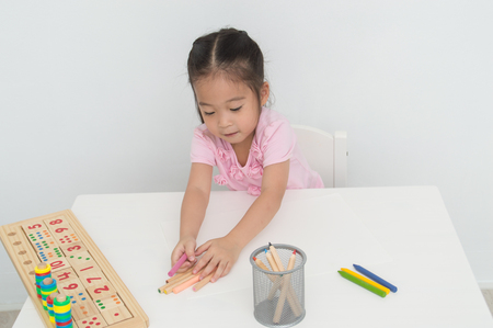 Concept Family. Familys are drawing activities in the home. Family is doing happy activities. Parents are teaching drawing children.