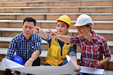Concepts Business Engineering, Professional engineers, Young Business people are planning construction. Stock Photo