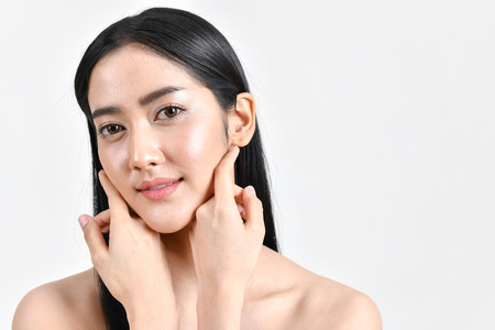 The concept of healthy beautiful woman. Beautiful women keep healthy. Beautiful women take care of skin health. Beautiful girl on white background Stock Photo