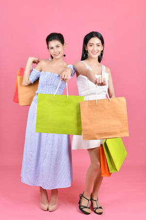 shopping concepts. Beautiful girls shopping in department stores. Beautiful girl happy to shop. Asian girls Exciting time to buy. (Online Business Ideas)