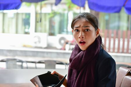 Bankrupt Business Concepts. Beautiful businesswoman was shocked when opening a wallet. Young businessmen have no money and are bankrupt.