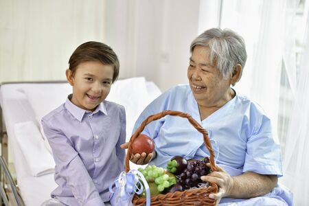 Patient Concept. Grandmas in the hospital. Waiting for someone to visit. Grandchildren visit grandma at the hospital. Grandma is happy to meet grandchildren.