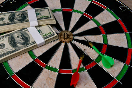 Finance Business Concepts. Businessman is playing darts. Businessmen are aiming for work. Businessman looking at a lot of money. Stock fotó