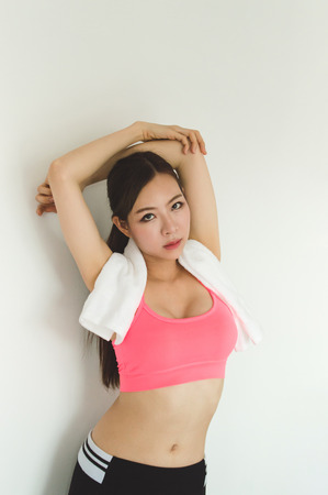 Sports concept. Beautiful girl is exercising in the home with warm up. Beautiful girl is happy to exercise.Beautiful women playing sports for health. Imagens