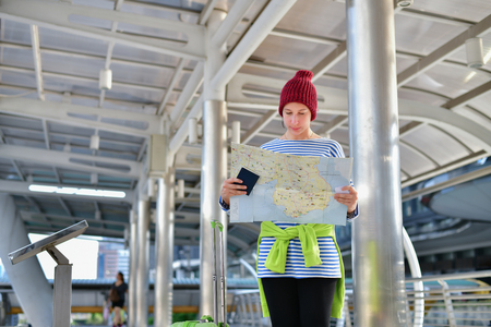 Travel Concepts. The girl is traveling in winter. The girls are excited and glad to travel. Beautiful girl is walking on the platform.
