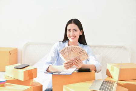 Sme business concept. Young people are packing their packages.Delivery business Small and Medium Enterprise (SMEs). Young Owner Start up for Business Online. Beautiful girls are counting money.
