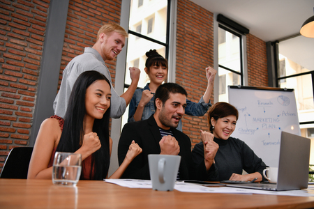 Business concept. Businessmen are shouting with joy. Business people are raising their hands for business success. 스톡 콘텐츠