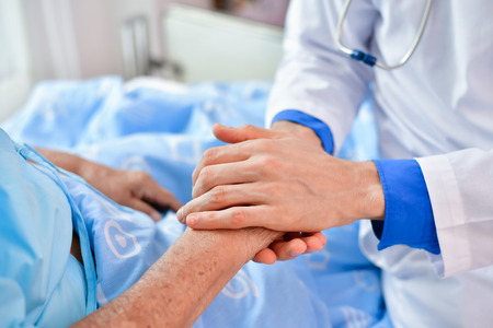 Concept of healing care. The doctor is healing old woman. The doctor is working in the hospital. Doctors encourage and treat elderly patients.