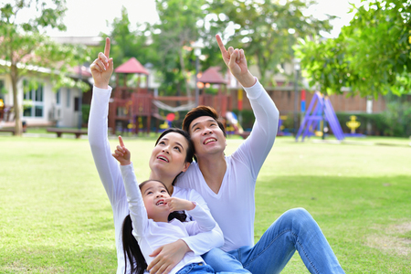 Family Concept. Family is doing happy activities at Playground. Parents with children are playing in the garden.
