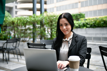 Business concept. Young businesswomen in the coffee shop. Young business people are working happily.
