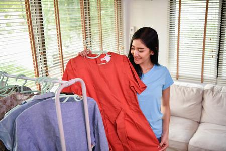 Shopping concept. Asian girls are enjoying shopping. Asian girls are trying their favorite clothes.