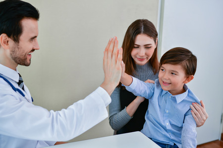 Health Concepts. The doctor is examining the patients health. Children are happy to be hospitalized. Stock Photo