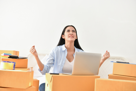 Sme business concept. Young people are packing their packages.Delivery business  Small and Medium Enterprise (SMEs). Beautiful women are delighted in success. Stock Photo