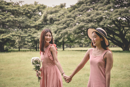 Holiday concept. Beautiful girl is getting flowers. Beautiful girl enjoys the scenery and nature.