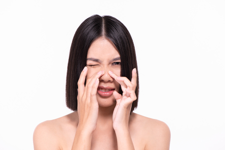 The concept of healthy beautiful woman. Beautiful women are experiencing skin problems. Beautiful women are squeezing acne on the face. Stock Photo