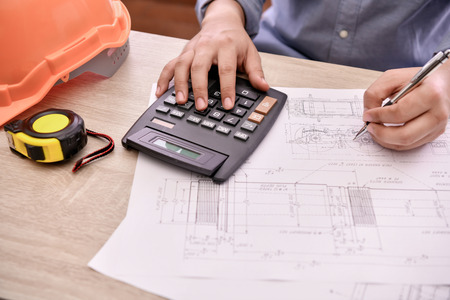 Engineering concept. The engineer is working in the office. Engineers are designing their work calculations. Фото со стока