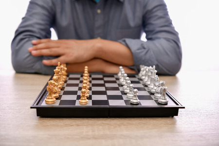 Leadership Concepts. Chess is a leader. Comparing chess is a strategic business plan. Chess game on a black background.