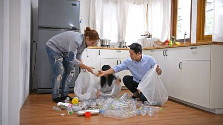 Family concept. Families are helping to separate recyclable waste in the kitchen.
