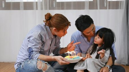 Family concept. Brother is singing a birthday wish to her sister.