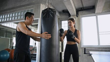 Exercise concept. Women are practicing boxing with assistants in the gym. Stok Fotoğraf