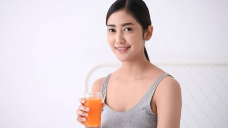 Health concept. Asian women are drinking delicious juices.