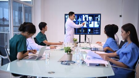Medical concept. The male and female doctors are meeting together in the room.