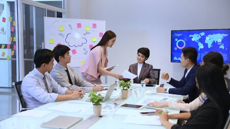 Business concept. Young businessmen are distributing documents to present their work.