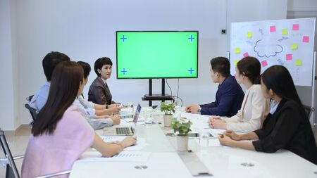 Business concept. A group of business people looking at the monitor. 4k Resolution.