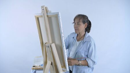 Artist Concept. A middle aged woman drawing in a studio room. 4k Resolution.