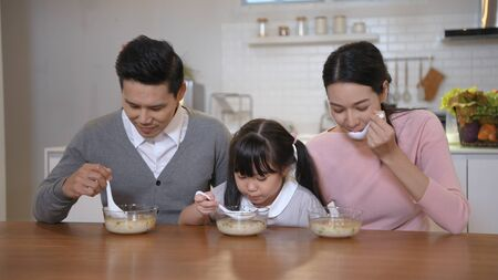 Family concept. The family is having breakfast together. 4k Resolution.