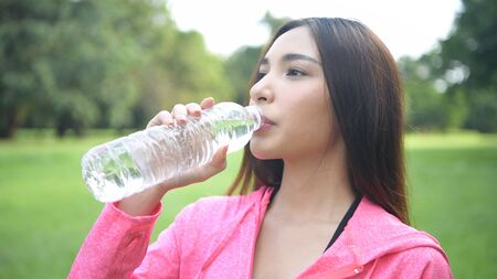 Exercise concepts. Beautiful women are drinking water with freshness in the park. 4k Resolution.