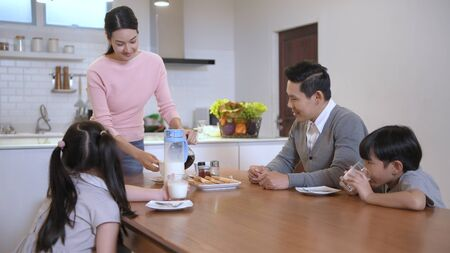 Holiday concept. The family is having breakfast together. 4k Resolution. Stock Photo