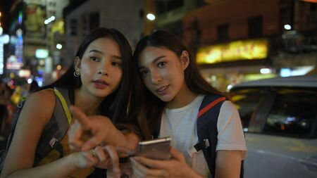 Travel concept. Young women opening mobile phones to search for travel information. 4k Resolution.