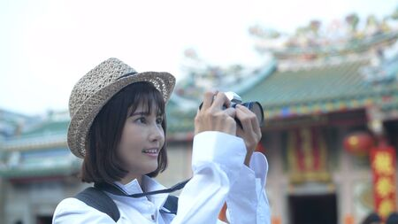 Travel concept. A beautiful girl is enjoying taking pictures in the city. 4k Resolution.