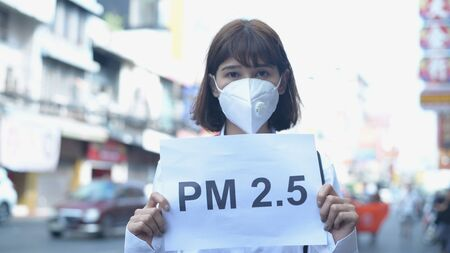 Concept of pollution prevention. The girl wearing a mask is holding a sign indicating the message. 4k Resolution.