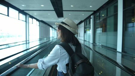 An Asian woman is traveling at the airport. 4k Resolution.