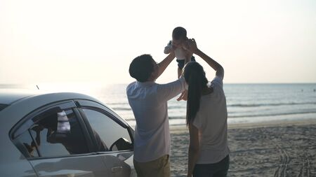 Holiday concept. Parents playing with baby on the beach. 4k Resolution.