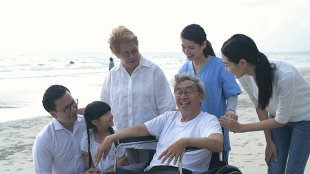 Holiday concept. A big family is having a nice chat on the beach. 4k Resolution.