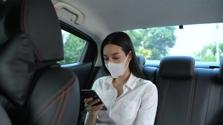 Travel Concept. The masked woman is traveling to the doctor at the hospital.